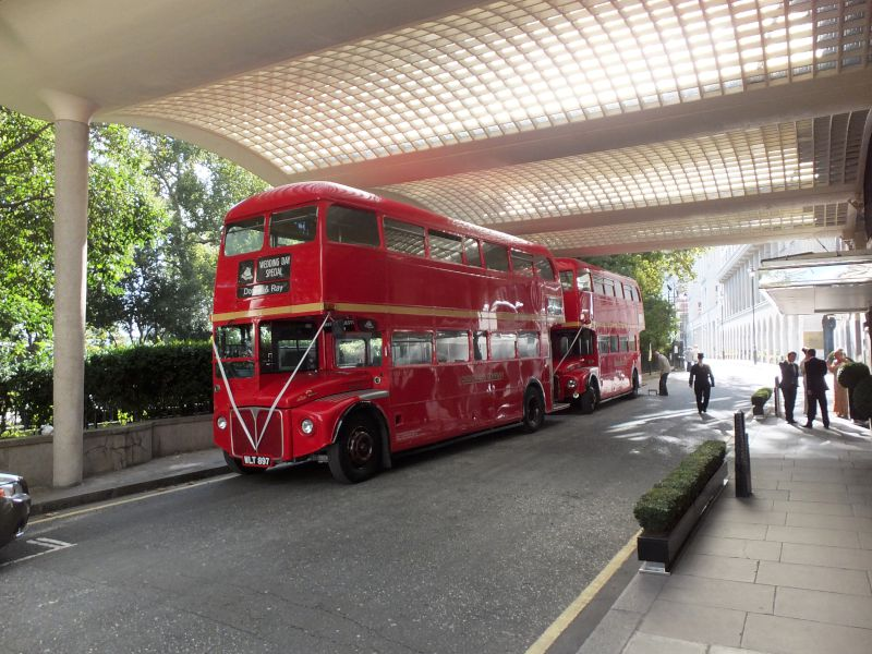 2 buses waiting wedding party at Savoy Hotel