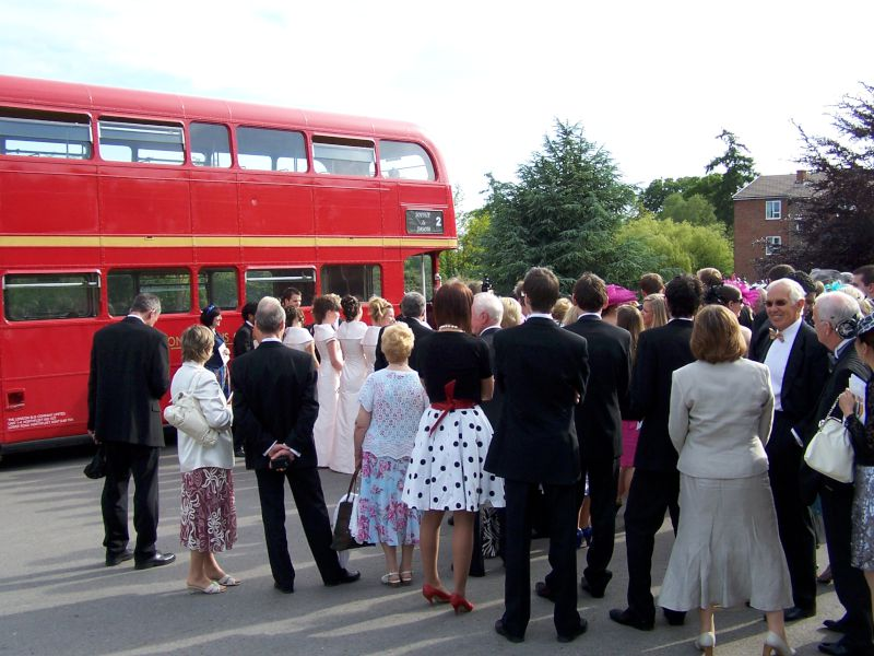 Wedding party waiting to board the bus